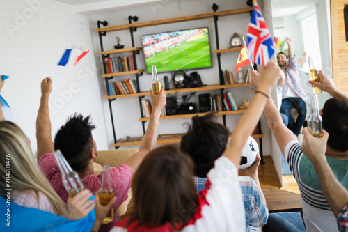 Group of multi-ethnic people celebrating football game