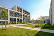 Leinwanddruck Bild - Modern residential buildings with outdoor facilities, Facade of new low-energy houses