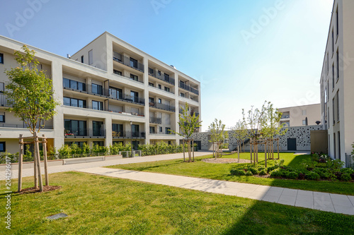 Leinwanddruck Bild Modern residential buildings with outdoor facilities, Facade of new low-energy houses