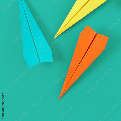 Flat lay set colorful paper plane with copy space on pastel background © kucherav