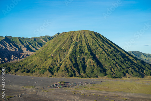 Plexiglas Blauw Beautiful view landscape of active volcano crater with fog and smoke at Bromo Tengger Semeru National Park, East Java, of Indonesia.