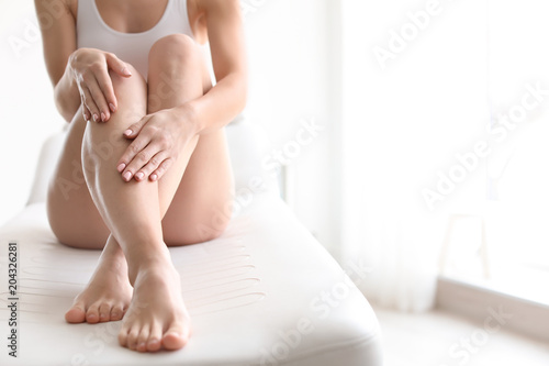 Leinwanddruck Bild Young woman showing smooth silky skin after epilation at home