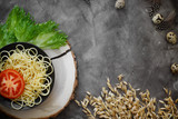 Italian spaghetti in a plate, next to bright vegetables, quail eggs and spikelets of wheat - 204337474