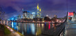 Picturesque panoramic view of business district with skyscrapers and Old Town with mirror reflections in the river during foggy morning blue hour, Frankfurt am Main, Germany