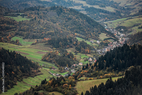 Plexiglas Landschappen view of the country town in the valley among the hills and trees