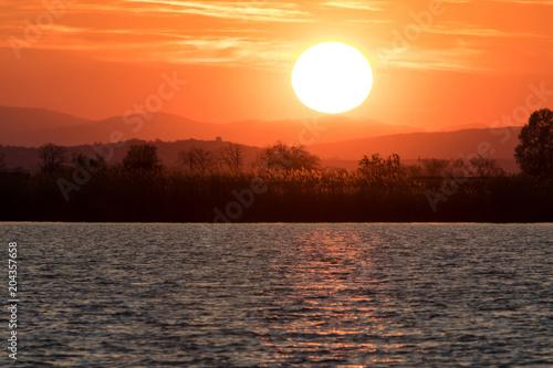 Aluminium Oranje eclat sunset over Neusiedler lake, Austria