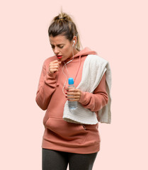 Young sport woman wearing workout sweatshirt sick and coughing, suffering asthma or bronchitis, medicine concept © Aaron Amat