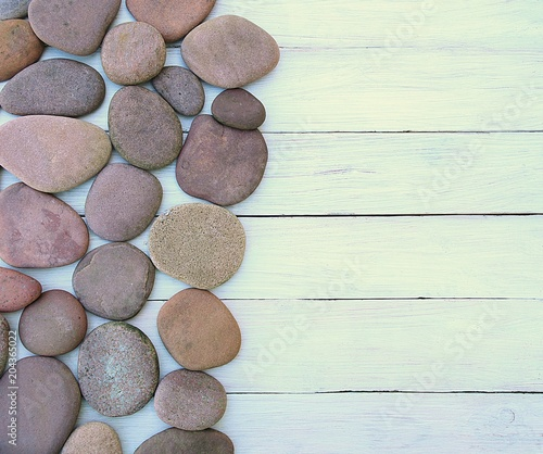 Fotobehang Zen Pebbles or stones on white wood planks background. Aged wooden board and red pebbles, top view, empty place.