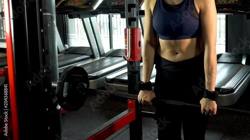 Wall mural Exercise in the gym, man and women want to have a beautiful body with fitness.