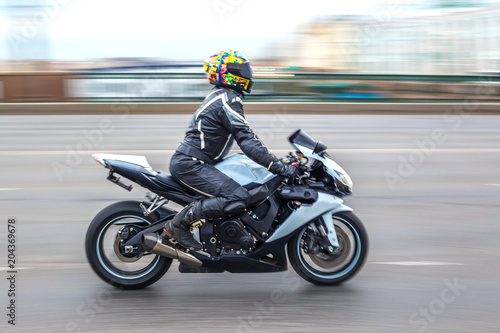motorcyclist in motion on the road at speed