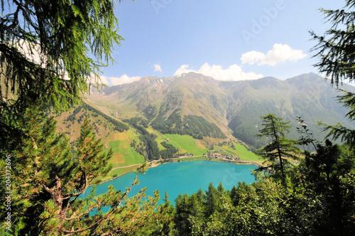 Fotobehang Blauwe hemel Gebirge Südtirol Berge See