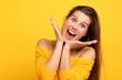 Quadro Woman against yellow wall background