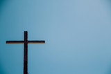 The Old wooden cross with the blue sky background.