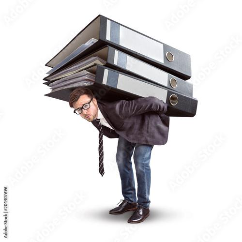 Mann trägt einen riesigen Stapel Aktenordner © photoschmidt