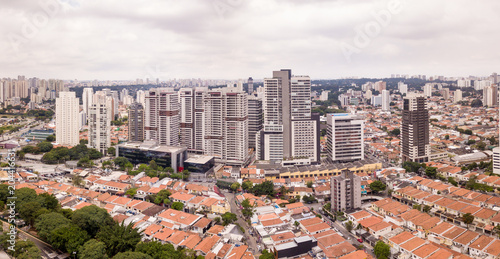 Aerial view of Sao Paulo with buildings and houses on cloudy winter day.