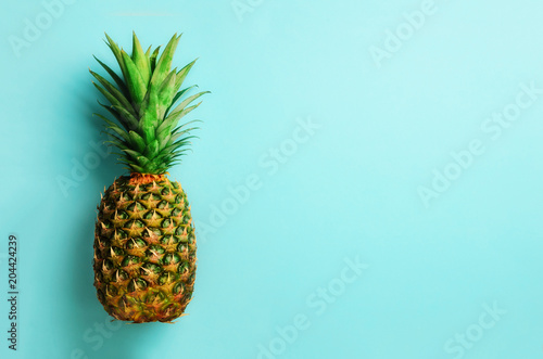 Pineapple on blue background. Top View. Copy Space. Pattern for minimal style. Pop art design, creative concept - 204424239
