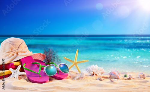 Beach Accessories With Seashells On Seashore - Summer Holidays
