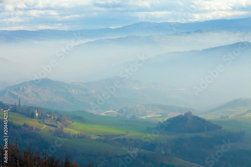 Fotobehang Toscane fog in the valleys of Tuscany
