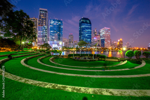 Night lights at the park in the heart of Bangkok. People have to sit and relax. Take a break before returning to your accommodation or talk to a friend (Benjakitti Park).