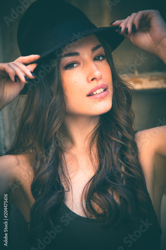 beautiful young woman portrait with hat summer day in the city