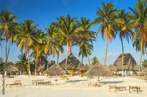 Fotobehang Zanzibar Beautiful Zanzibar beach hotel with traditional exotic beach huts, Zanzibar, Tanzania.