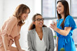 business, technology and people concept - businesswomen with smartphone working at office