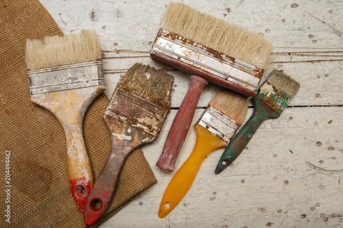 Fototapeta Old paintbrushes on vintage background