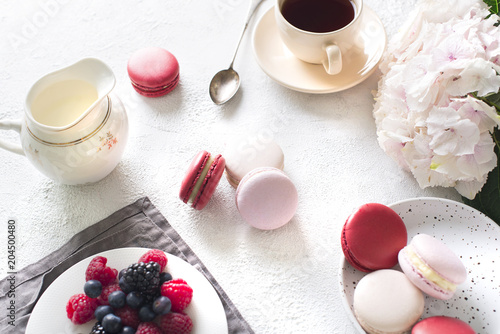 Fototapeta Spaing mood with color macaroons? cup of coffee and flowers