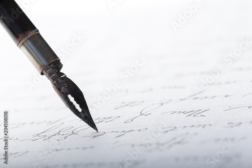 Fountain pen on an antique handwritten letter - 204508018
