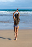 Back view of black woman with summer braids enjoying and relaxing on vacation at the beach. Female in fashionable ethnic bikini. - 204511686