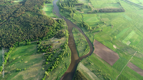Fotobehang Cappuccino Aerial view of natural river in spring