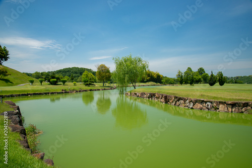 Fotobehang Blauwe jeans ゴルフ場