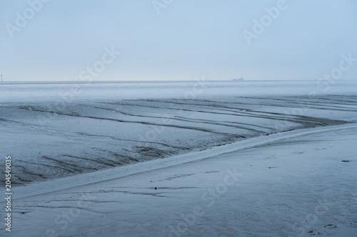 Plexiglas Noordzee Winterstimmung über dem Watt der Nordseeküste bei Wremen (Niedersachsen)
