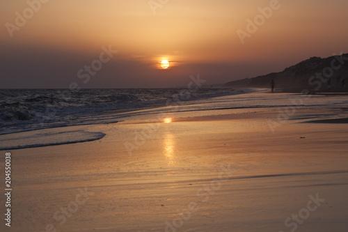Plexiglas Strand Sunset Reflexion on the beach , Mazagon , Huelva , Andalusia , Atlantic coast , Spain