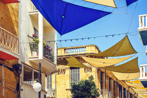 Daylight view to sun shades above Ledra street