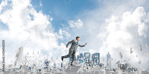Precise businessman in suit running with phone.