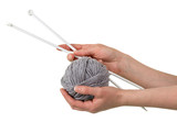 Ball of soft gray yarn and knitting needles in woman hands isolated on white - 204575245