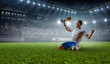 Leinwanddruck Bild - Soccer player at stadium. Mixed media