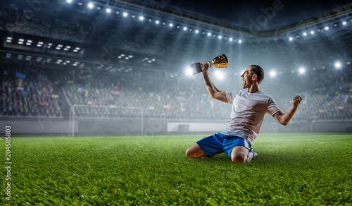 Aluminium Voetbal Soccer player at stadium. Mixed media