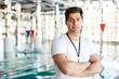 Quadro Cross-armed man in activewear looking at camera while having break between trainings by swimming-pool