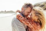 Loving senior couple embracing on the beach