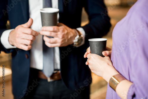 Business people with coffee cups