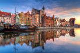 Beautiful old town of Gdansk reflected in Motlawa river at sunrise, Poland. - 204606299