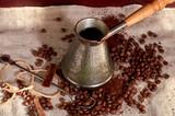 coffee beans, cinnamon and coffee maker