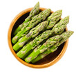 Fresh green asparagus tips in wooden bowl. Sparrow grass shoots. Cultivated Asparagus officinalis. Vegetable with thick stems and closed buds. Isolated macro food photo close up from above over white.