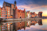 Beautiful old town of Gdansk reflected in Motlawa river at sunrise, Poland. - 204634648