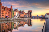 Beautiful old town of Gdansk reflected in Motlawa river at sunrise, Poland. - 204634679