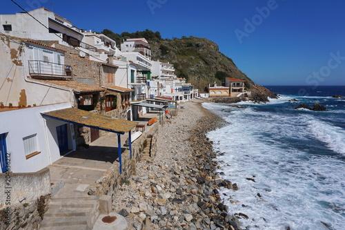 Spain old fishermen houses along the coast in Cala Margarida in Palamos, Mediterranean sea, Costa Brava, Catalonia, Baix Emporda