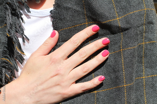 Plexiglas Manicure Beautiful female hand with manicure. Saturated bright pink nail polish and and groomed fingers.