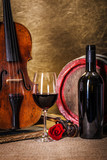 Red wine in glass, barell and violin